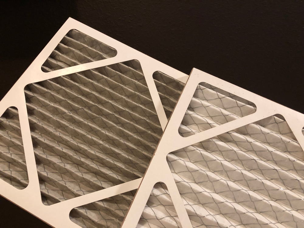 image showing comparison of a clean and dirty furnace filter